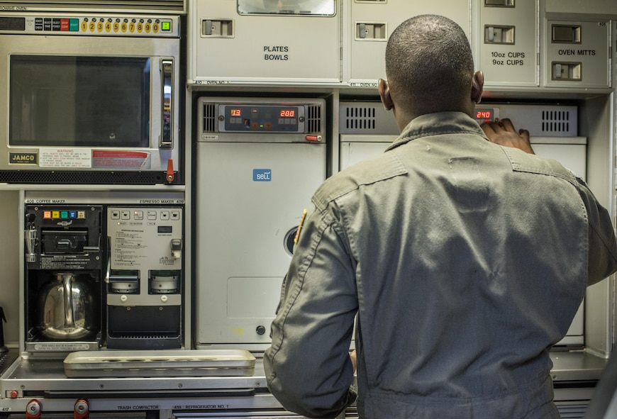 Tech. Sgt. Anthony Montgomery, 201st Airlift Squadron flight attendant, prepares the flight kitchen before a Mission Readiness Airlift at Joint Base Andrews, Md., March 31, 2017. The 201st AS and their three C-40 Clippers are tasked with congressional transports and Mission Readiness Airlifts through the Office of the Secretary of Defense and Vice Chief of Staff of the Air Force. (U.S. Air Force photo by Senior Airman Jordyn Fetter)