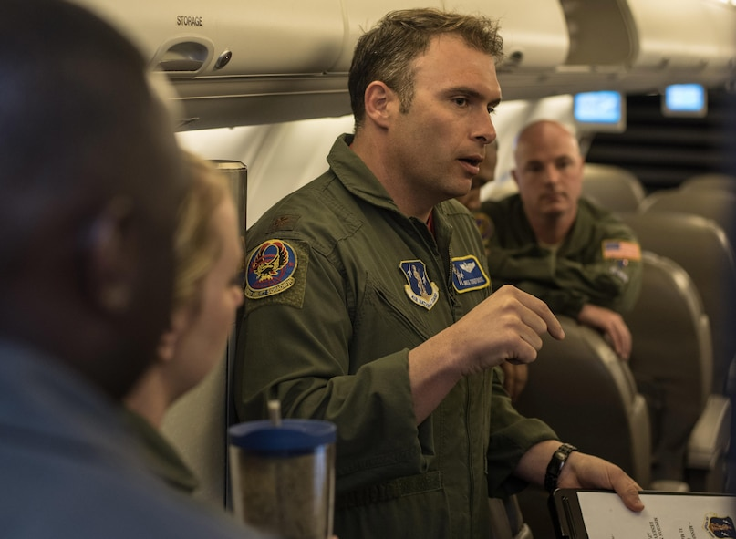 Maj. Greg Zickefoose, 201st Airlift Squadron assistant director of operations, gives a pre-flight briefing before a Mission Readiness Airlift at Joint Base Andrews, Md., March 31, 2017. The squadron conducts Mission Readiness Airlifts, which are authorized by the National Guard Bureau for personnel and cargo requiring transportation to meet training requirements. They also provide aircrews with practical experience involving transporting loads, unfamiliar operating locations and other qualification requirements. (U.S. Air Force photo by Senior Airman Jordyn Fetter)