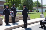 Distribution police chief Douglas Schraeder takes a moment of silence to show his respect for the men, women and K9's who have died in the line of duty nationwide at the National Police Week wreath laying ceremony on May 15.