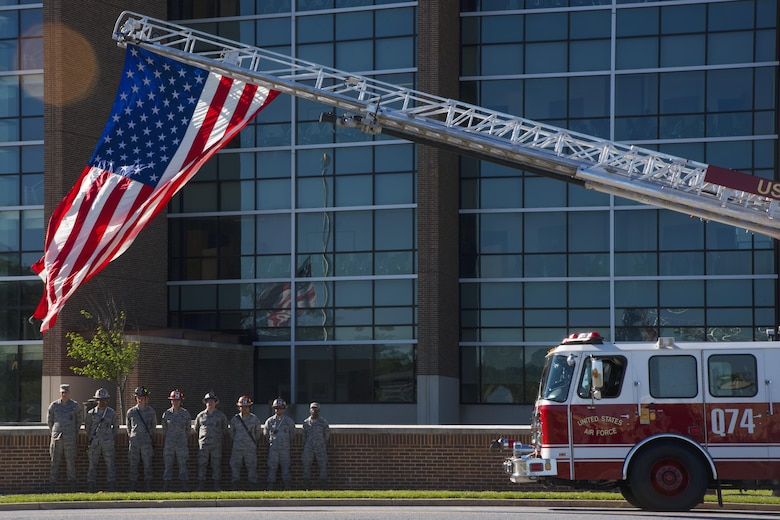 Firefighters stand at ease during the 2017 National Police Week Wreath Laying Ceremony at Joint Base Andrews, Md., May 15, 2017. National Police Week is meant to remember the fallen and honor those who serve as police officers or security forces members. (U.S. Air Force photo by Airman 1st Class Valentina Lopez)