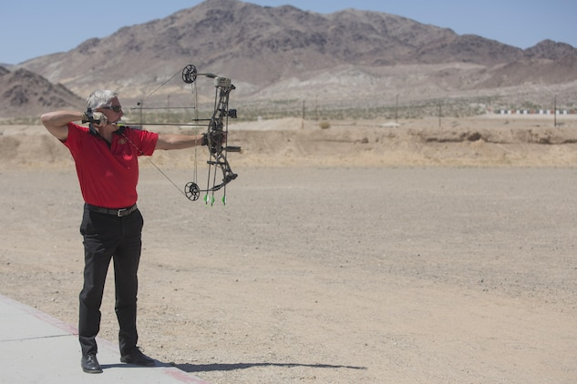 Creg McDonald, liaison to Marine Air Ground Task Force Training Command, Joint Improvised Threat Defeat Organization, fires the ceremonial first shot at the opening of the archery range on Range 3A at the installation rifle range aboard Marine Corps Air Ground Combat Center, Twentynine Palms, Calif., May 11, 2017. The idea was proposed through the installation's newly-implemented Facebook group, Make the Stumps Better, which is an initiative proliferated by Combat Center Commanding General, Brig. Gen. William F. Mullen III, in order to solicit opinions and concerns from Combat Center patrons and determine actionable change from leadership. (U.S. Marine Corps photo by Cpl. Thomas Mudd)