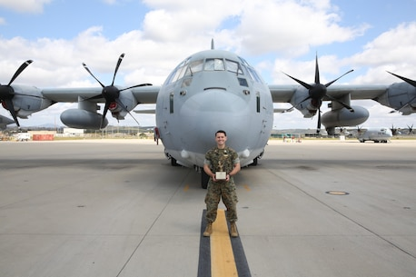 Capt. Christopher Lavergne, a KC-130J Super Hercules pilot with Marine Aerial Refueler Transport Squadron (VMGR) 352, proudly displays the 2017 Marine Corps Aviation Association Henry Wildfang award in front of a KC-130J at Marine Corps Air Station Miramar, Calif., March 27. VMGR-352 received the Henry Wildfang award for successful mission accomplishments and the most mishap free hours. (U.S. Marine Corps photo by Lance Cpl. Jake M.T. McClung/Released)