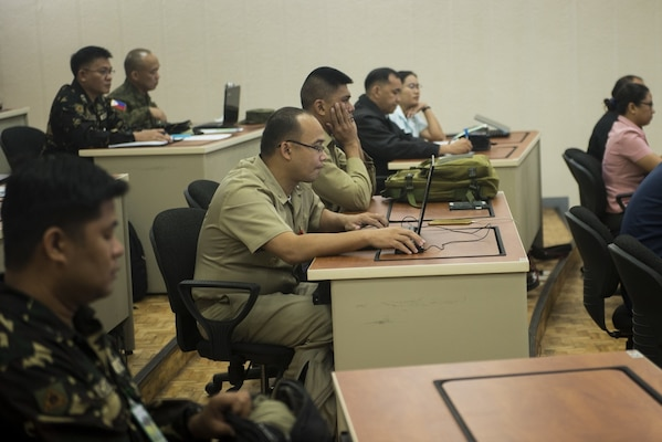 Members of the Armed Forces of the Philippines attend a briefing on cybersecurity and risk management during Balikatan 2017 at Camp Aguinaldo, Quezon City, May 16, 2017. The focus group is part of a four-day cyber security subject matter expert exchange between AFP and U.S. military members designed to discuss information on the fundamentals of cybersecurity and network risk management. Balikatan is an annual U.S.-Philippine bilateral military exercise focused on a variety of missions, including humanitarian assistance and disaster relief, counterterrorism, and other combined military operations.