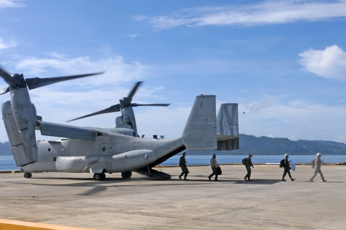 U.S. Soldiers and Sailors exit a U.S. Marine MV-22 Osprey tiltrotor aircraft during civil military activities from the sea at Casiguran Port, Casiguran, May 15, 2017. By training for humanitarian assistance and disaster response operations, U.S. and Philippine forces are better prepared to provide relief from the sea to remote and austere areas of the Philippines. Balikatan is an annual U.S.-Philippine bilateral military exercise focused on a variety of missions, including humanitarian assistance and disaster relief, counterterrorism and other combined military operations.