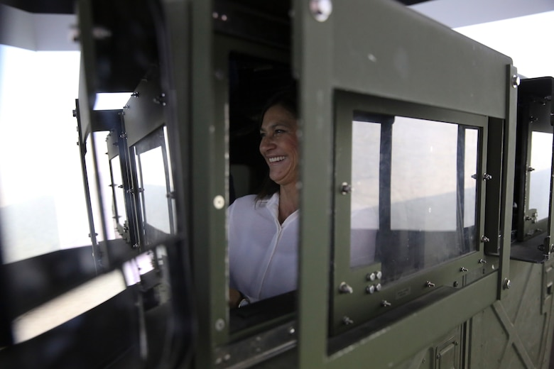 Josi Kenline, Chief of Staff for Chairman Robert Lovingood, 1st District Supervisor, operates a simulated High Mobility Multipurpose Wheeled Vehicle at the Battle Simulation Center, during a tour of the Marine Corps Air Ground Combat Center, Twentynine Palms, Calif., for the San Bernardino County Board of Supervisors, May 12, 2017. The tour was hosted by G-5 Government and External Affairs. (U.S. Marine Corps photo by Cpl. Medina Ayala-Lo)