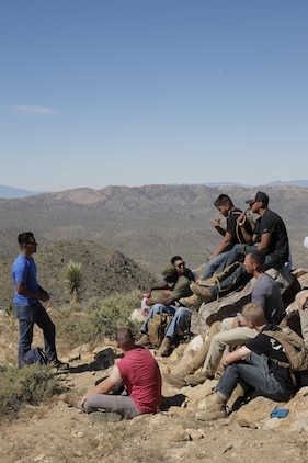 Sgt. Gonzalo Torres, instructor, Marine Corps Communication-Electronics School, speaks with a group Marines in the Round Table Mentorship Program on top of Ryan Mountain in Joshua Tree National Park, Calif. May 12, 2017. Round Table is a mentorship program created by MCCES to break down walls between leadership and junior Marines by encouraging open dialogue and develop professional relationships across the ranks. (U.S. Marine Corps photo by Cpl. Dave Flores)