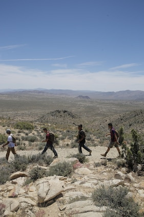 Marines in the Round Table Mentorship Program hike back down Ryan Mountain in Joshua Tree National Park, Calif. May 12, 2017. Round Table is a mentorship program created by MCCES to break down walls between leadership and junior Marines by encouraging open dialogue and develop professional relationships across the ranks. (U.S. Marine Corps photo by Cpl. Dave Flores)