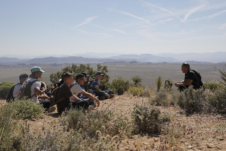 Sgt. Jordan Collins, instructor, Marine Corps Communication-Electronics School, speaks with a group Marines in the Round Table Mentorship Program on top of Ryan Mountain in Joshua Tree National Park, Calif. May 12, 2017. Round Table is a mentorship program created by MCCES to break down walls between leadership and junior Marines by encouraging open dialogue and develop professional relationships across the ranks. (U.S. Marine Corps photo by Cpl. Dave Flores)