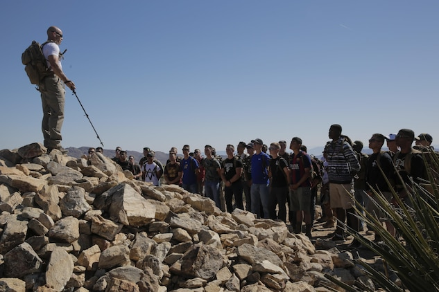 1st Sgt. Ryan Cantrell, Company B First Sergeant, Marine Corps Communication-Electronics School, speaks to Marines in the Round Table Mentorship Program on top of Ryan Mountain in Joshua Tree National Park, Calif., May 12, 2017. Round Table is a mentorship program created by MCCES to break down walls between leadership and junior Marines by encouraging open dialogue and develop professional relationships across the ranks. (U.S. Marine Corps photo by Cpl. Dave Flores)