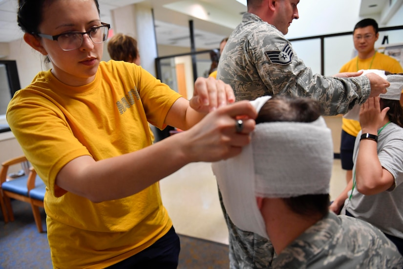 U.S. Navy Seaman Apprentice Katharine Soliz, Naval Health Clinic Charleston general duty corpsman, learns how to stabilize a broken jaw during the second annual Lowcountry Medical Skills Expo here, May 17, 2017. Nearly 300 people from eight agencies trained on nine medical competencies including sutures, mass blood transfusions, IVs and litter carrying techniques during the expo.