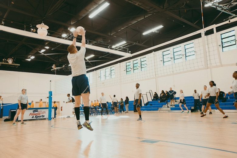 Airmen compete in a volleyball game during Wingman/Shipmate Day at Joint Base Andrews, Md., May 16, 2017. Wingman/Shipmate Day is a day for Airmen and Sailors to strengthen bonds and build new ones. (U.S. Air Force photo by Senior Airman Delano Scott)