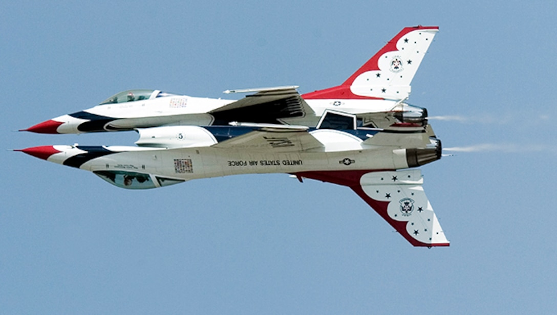 Thunderbirds No. 5 and 6 perform a reflection pass during a practice show at Scott Air Force Base, Ill. (U.S. Air Force photo/Master Sgt. Jack Braden)