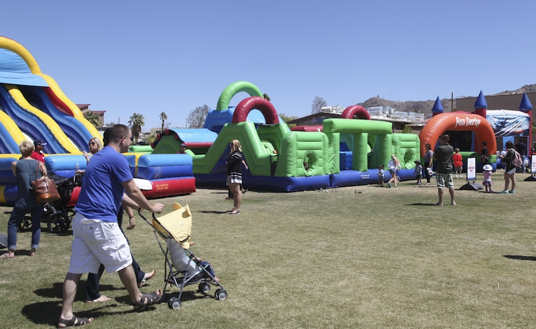 Combat Center patrons enjoy bounce houses during the annual We Salute You Fest at Victory Field aboard the Marine Corps Air Ground Combat Center, Twentynine Palms, Calif., Saturday. Marine Corps Community Services hosts the event to show their appreciation for all the hard working service members who protect this country.