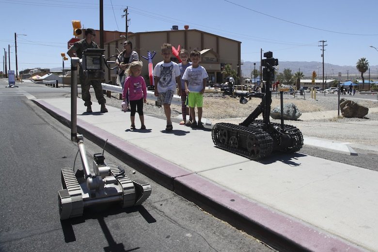 Combat Center children learn from a Marine with Explosive Ordnance Disposal about their EOD observation robots during the annual We Salute You Fest at Victory Field aboard the Marine Corps Air Ground Combat Center, Twentynine Palms, Calif., Saturday. Marine Corps Community Services hosts the event to show their appreciation for all the hard working service members who protect this country.