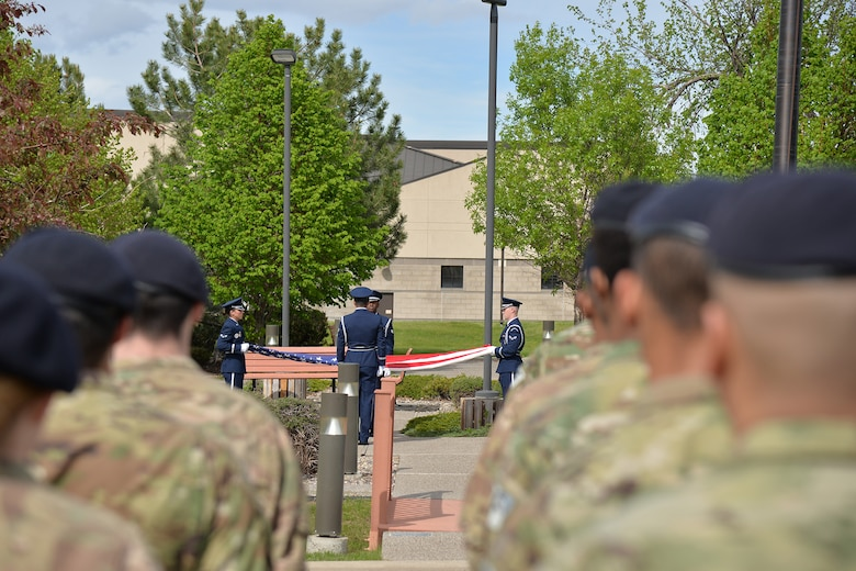 Members of the Malmstrom Base Honor Guard fold a flag at a retreat ceremony during National Police Week May 15, 2017, at Malmstrom Air Force Base, Mont. A flag was folded during the retreat ceremony to honor law enforcement members who have fallen in the line of duty. (U.S. Air Force photo/Airman 1st Class Daniel Brosam)