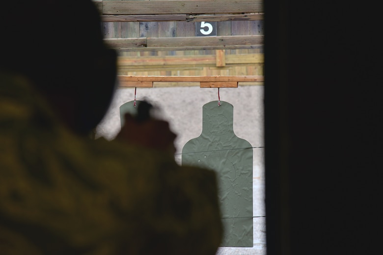Senior Airman Raymond Dwoznick, 741st Missile Security Forces Squadron tactical response force assaulter, competes in an M-9 pistol shooting competition during National Police Week May 17, 2017, at Malmstrom Air Force Base, Mont. Airmen from the base, the Office of Special Investigations and local law enforcement participated in a shooting competition at the base's combat arms training and maintenance range. (U.S. Air Force photo/Airman 1st Class Daniel Brosam)