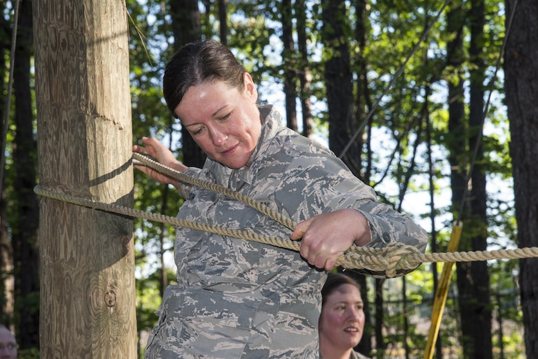 Commissioned Officer Training students balances across a rope obstacle at the Officer Training School's Vigilant Warrior training site, April 25, 2017, near Titus, Ala. Vigilant Warrior is a 200 acre expeditionary training site. (U.S. Air Force photo/ Senior Airman Alexa Culbert)