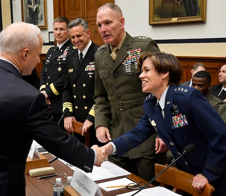 Lt. Gen. Gina Grosso, the Air Force deputy chief of staff for manpower and personnel service greets Rep. Michael Coffman, R-Colo., the chairman of the Military Personnel Subcommittee before testifying on military personnel posture May 17, 2017, in Washington, D.C. Grosso testified with Marine Corps Lt. Gen. Mark Brilakis, the U.S. Marine Corps deputy commandant for manpower and reserve affairs; Navy Vice Adm. Robert Burke, the U.S. Navy Chief of naval personnel; and Army Maj. Gen. Erik Peterson, the U.S. Army director of Army aviation. (U.S. Air Force photo/Wayne A. Clark)