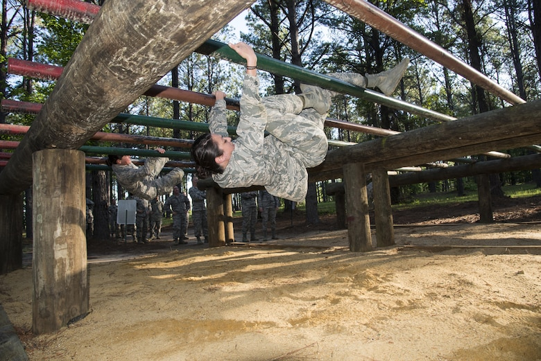 Commissioned Officer Training student maneuvers through an obstacle at the Officer Training School's Vigilant Warrior training site, April 25, 2017, Maxwell Air Force Base, Ala. This was the first COT class to the Vigilant Warrior training site, instead of the High Ropes Course, in order to better align the course with the Total Force Officer Training course. (U.S. Air Force photo/ Senior Airman Alexa Culbert)