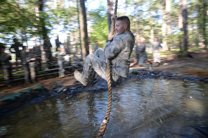 Commissioned Officer Training student swings across the last obstacle of the Officer Training School's Vigilant Warrior training site, April 25, 2017, Maxwell Air Force Base, Ala. Unlike Total Force Officer Training cadets, COT students enter training with officer rank and are recruited to serve in specialized career fields. (U.S. Air Force photo/ Senior Airman Alexa Culbert)