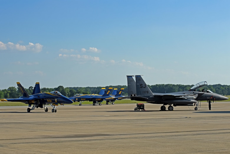 The U.S. Navy Blue Angels F/A-18 Hornets taxi after landing, May 17, 2017, at Seymour Johnson Air Force Base, North Carolina. The Blue Angels pilots will perform aerial stunts and routines during the Wings Over Wayne Air Show, May 20- 21. (U.S. Air Force photo by Senior Airman Ashley Maldonado)