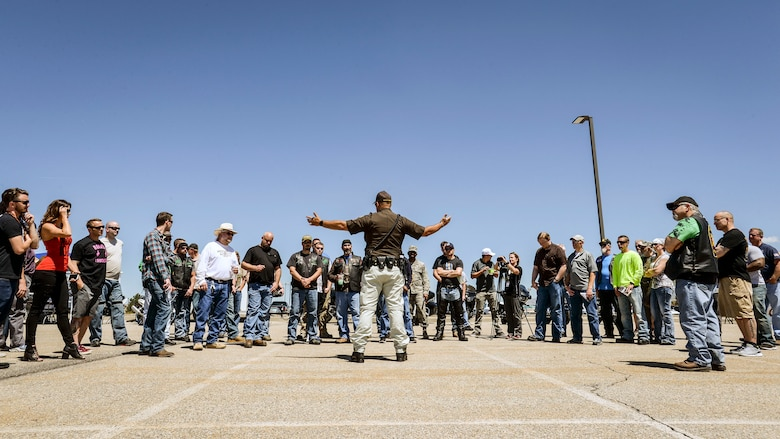 Sgt. Donavan Lucas of the Utah Highway Patrol talks motorcycle safety with a Hill Air Force Base employees May 11. Lucas also demonstrated emergency maneuvers such as high-speed braking during Hill AFB's 3rd Annual Motorcycle Rodeo. (U.S. Air Force/Paul Holcomb)