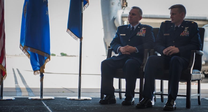 Maj. William Mendel, 20th Special Operations Squadron, sits next to Brig. Gen. William Holt, Air Force Special Operations Command director of operations, Hurlburt Field, Fla., during his Distinguished Flying Cross ceremony at Cannon Air Force Base, N.M., May 15, 2017. Maj. Mendel and other aircraft in his formation received heavy and effective hostile fire during a mission in Africa, but managed to save the lives of four critically wounded individuals and complete the mission. He and other crew members were presented the Distinguished Flying Cross, a medal created in 1918 to reward those who display heroism or extraordinary achievement while participating in an aerial flight. Maj. Mendel became the 79th Airman under Air Force Special Operations Command to receive the honor. (U.S. Air Force photo by Senior Airman Lane T. Plummer)