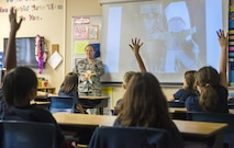 Staff Sgt. Candice Landsaw, 433rd Force Support Squadron system administrator, takes questions from 2nd grade students at Buckner Fanning School at Mission Springs May, 11, 2017. Landsaw took photos of Flat Stanley during her deployment to Al Udeid Air Base and and shared them with the students upon her return. (U.S. Air Force photo by Benjamin Faske)