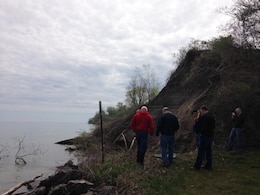 A Sodus, New York bluff was hit with severe erosion due to high Lake Ontario water levels and the town placed small stones and broken concrete to try and support the area.  A U.S. Army Corps of Engineers Buffalo District Technical Assistance Field Team recommended short term fixes of placing geotextile material, larger stones and creating gentler slopes.