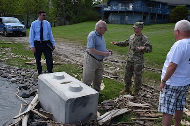 U.S. Army Corps of Engineers Buffalo District Commander Adam Czekanski met with the Mayor of Sodus, New York Chris Tertinek (both centered) and local emergency management officials to discuss Army Corps of Engineers flood supplemental support efforts. They also toured areas affected by high Lake Ontario water in Sodus, New York.