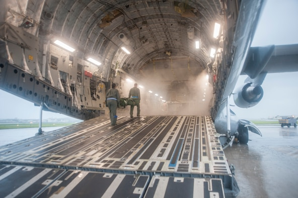 U.S. Airmen assigned to the 18th Aerospace Evacuation Squadron (AES) load equipment into a C-17 Globemaster III May 13, 2017, at Kadena Air Base, Japan. The 18th AES maintains a forward presence and supports medical contingencies in the Pacific to include the only neonatal air facility in the region. (U.S. Air Force photo by Senior Airman Quay Drawdy)