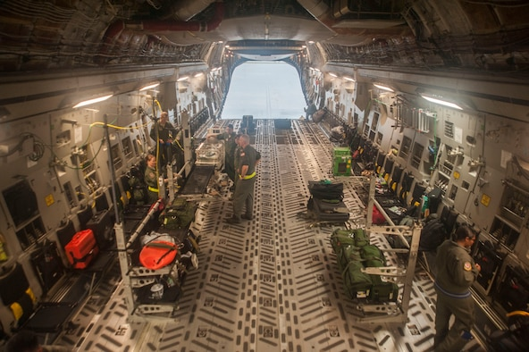 "U.S. Airmen assigned to the 18th Aerospace Evacuation Squadron (AES) work to secure medical equipment in a C-17 Globemaster III May 13, 2017, at Kadena Air Base, Japan. Airmen with the 18th AES worked with U.S. Navy Sailors to outfit a ""Giraffe"" omnibed system into a C-17 Globemaster III for the first time. (U.S. Air Force photo by Senior Airman Quay Drawdy)"