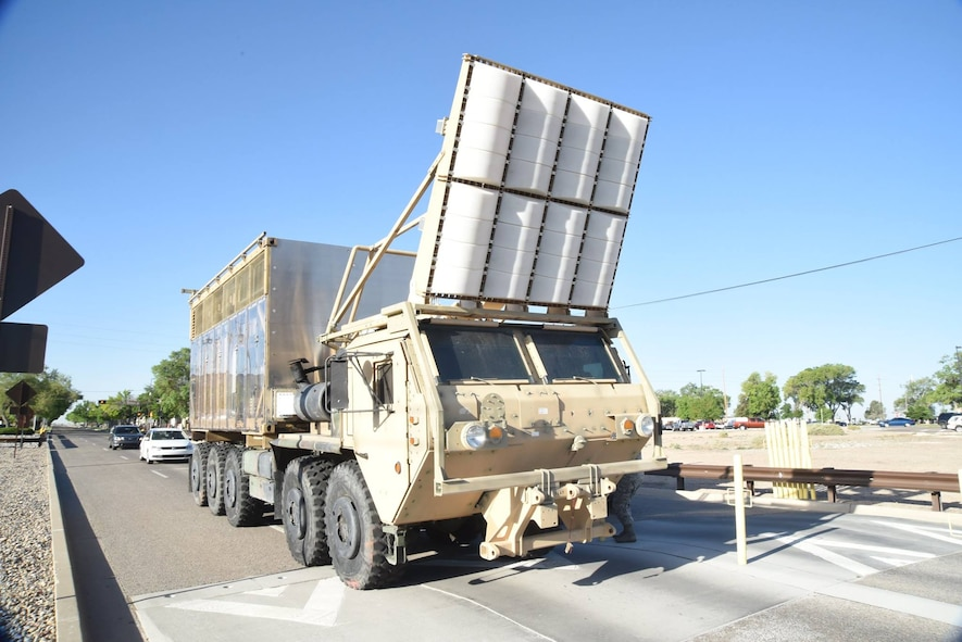MAX POWER drives out the Carlisle gate of Kirtland Air Force Base, May 16, 2017. The program will transfer to the US Army's Armament Research, Development and Engineering Center, or ARDEC, headquartered at Picatinny Arsenal, N.J.  ARDEC will continue R&D on MAX POWER locally however, at New Mexico Tech's Energetic Materials Research and Testing Center near Socorro. (U.S. Air Force Photo/Senior Airman Chandler Baker)