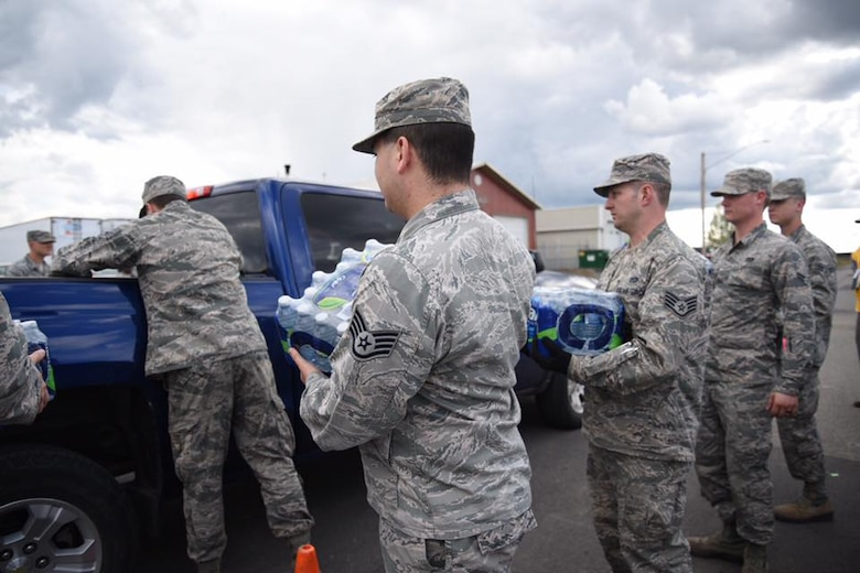 More than a dozen Airmen from Fairchild Air Force Base  joined City of Airway Heights officials and volunteers to hand out 24,000 gallons of bottled water in Airway Heights, Washington, May 18, 2017. The water is being distributed to city residents impacted by the city's advisory not to consume tap water after preliminary results of sampling conducted by Fairchild AFB indicated wells that supply the Airway Heights water system contained Perfluorooctanesulfonic (PFOS) and Perfluorooctanoic acids (PFOA) concentrations above the EPA's lifetime Health Advisory levels. (U.S. Air Force photo by 2nd Lt. Kate Miranda/released)