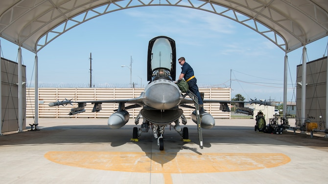 U.S. Air Force Airman 1st Class A.J. Kovacs, a 14th Aircraft Maintenance Unit crew chief, right, talks to Capt. Jacob Impellizzeri, left, a 14th Fighter Squadron F-16 Fighting Falcon pilot, prior to take-off at Kunsan Air Base, Republic of Korea, May 16, 2017. Team Misawa Airmen integrated with the 80th Fighter Squadrons daily operations to maintain readiness and proficiency and optimize uncommon training opportunities. (U.S. Air Force photo by Senior Airman Brittany A. Chase)