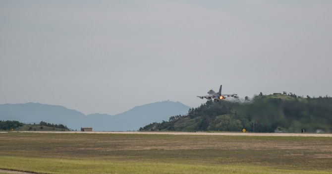A F-16 Fighting Falcon with the 14th Fighter Squadron takes-off at Kunsan Air Base, Republic of Korea, May 16, 2017. Due to routine flight line maintenance at Misawa Air Base, Japan, the 14th FS relocated to Kunsan AB, integrating operations with the 80th FS. By relocating to other bases, maintenance teams and pilots can continue training with allies and partners by conducting day-to-day operations until runway maintenance at Misawa AB is completed. (U.S. Air Force photo by Senior Airman Brittany A. Chase)