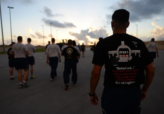 Airmen with the 734th Air Mobility Squadron and 44th Aerial Port Squadron participate in Port Dawg memorial to commemorate fallen air transportation specialists May 19, 2017, at Andersen Air Force Base, Guam.  Aerial porters, commonly referred to as Port Dawgs, are responsible for military logistics related to aerial ports and come from multiple units on Andersen AFB to include the 734th AMS, 36th Contingency Response Group and 36th Mission Readiness Squadron. (U.S. Air Force photo by Senior Airman Alexa Ann Henderson)