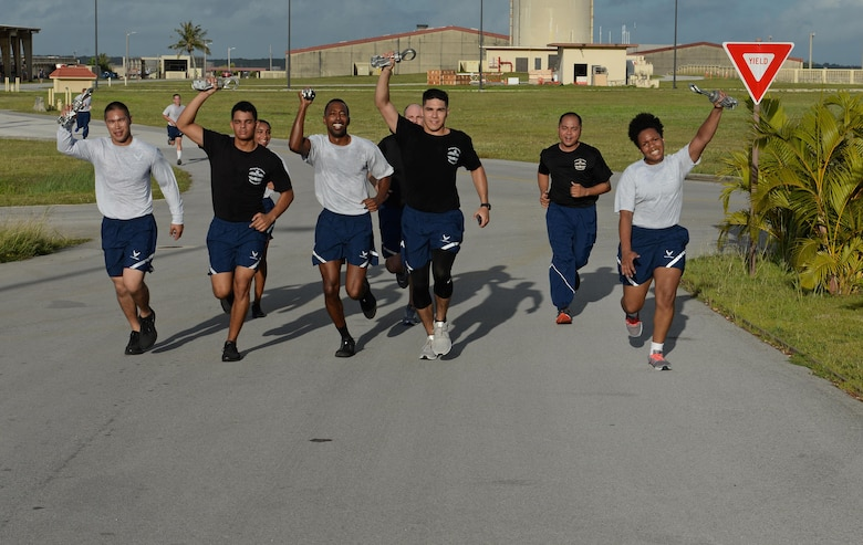 Airmen with the 734th Air Mobility Squadron finish the Port Dawg's Memorial Run carrying MB-1 devices to symbolize the five fallen air transportation specialists from the past year May 19, 2017, at Andersen Air Force Base, Guam. Aerial porters, commonly referred to as Port Dawgs, are responsible for military logistics related to aerial ports and come from multiple units on Andersen to include the 734th AMS, 36th Contingency Response Group and 36th Mission Readiness Squadron. (U.S. Air Force photo by Senior Airman Alexa Ann Henderson)