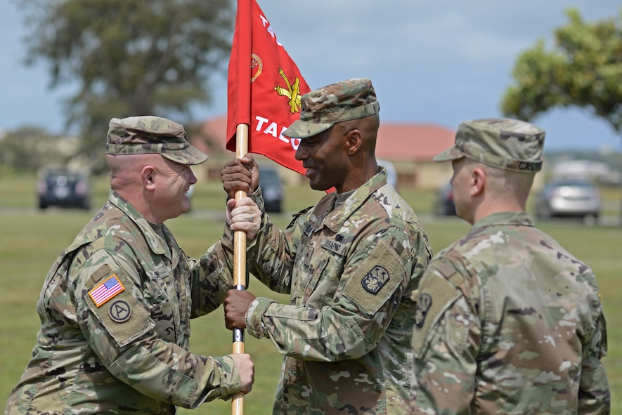 U.S. Army Lt. Col. Jeff Slown, Task Force Talon commander, relinquishes command to U.S. Army Brig. Gen. Sean A. Gainy, commander of the 94th Army Air and Missile Defense Command, during a change of command ceremony May 17, 2017, at Andersen Air Force Base. Task Force Talon is responsible for the U.S. Army's first forward deployed Terminal High Altitude Area Defense battery. (U.S. Air Force photo by Airman 1st Class Gerald R. Willis)