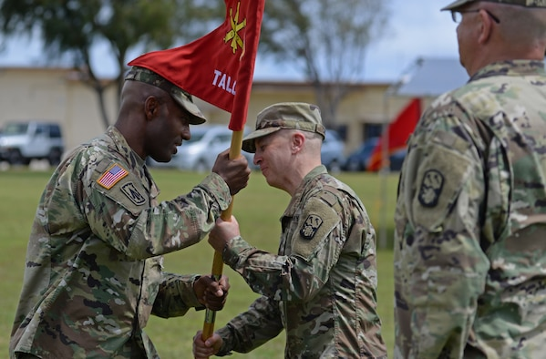 U.S. Army Lt. Col. John Castro, Task Force Talon commander (in-coming), assumes command from U.S. ArmyBrig. Gen. Sean A. Gainy, commander of the 94th Army Air and Missile Defense Command, during a change of command ceremony May 17, 2017, at Andersen Air Force Base. Task Force Talon is responsible for the U.S. Army's first forward deployed Terminal High Altitude Area Defense battery. (U.S. Air Force photo by Airman 1st Class Gerald R. Willis)