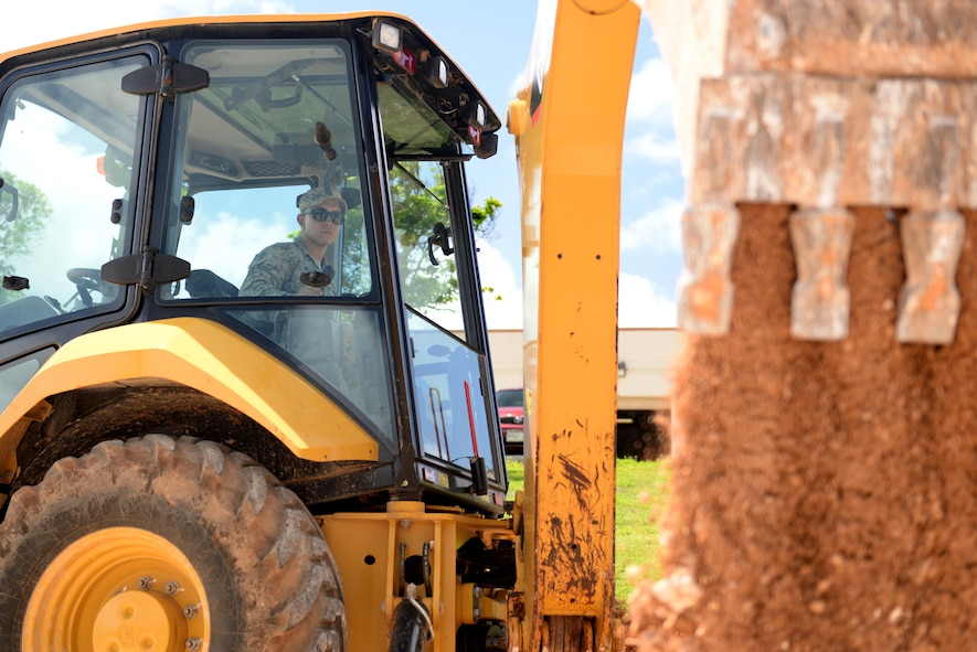 U.S. Air Force Airman 1st Class Austin Prendez, 36th Civil Engineering Squadron pavements and construction equipment journeyman, operates a front and backhoe loader May 2, 2017, at Andersen Air Force Base, Guam. The 36th CES is responsible for all facilities, infrastructure and two airfields with over 450 Airmen making it the largest squadron on Andersen AFB. (U.S. Air Force photo by Airman 1st Class Gerald R. Willis)