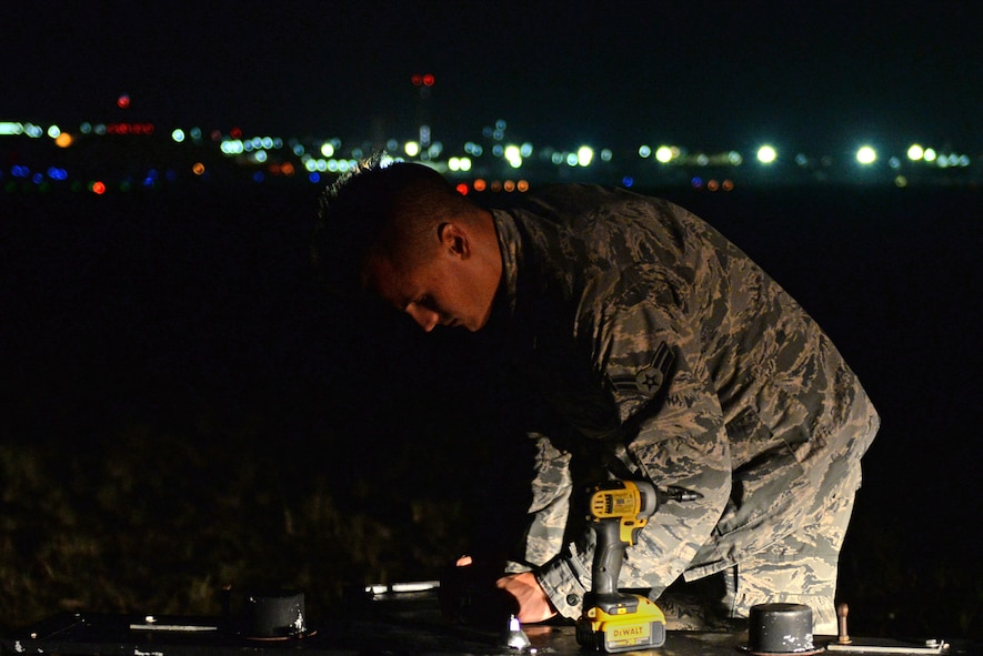 U.S. Air Force Airman 1st Class Ryan Muller, 36th Civil Engineering Squadron electrician, changes a light on the flightline May 16, 2017, at Andersen Air Force Base, Guam. The 36th CES is responsible for all facilities, infrastructure and two airfields with over 450 Airmen making it the largest squadron on Andersen AFB. (U.S. Air Force photo by Airman 1st Class Gerald R. Willis)