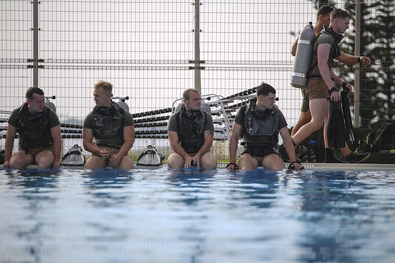 Reconnaissance Marines wait in line during a portion of the U.S. Marine Corps Combatant Divers Course on Camp Schwab, Okinawa, Japan, May 11, 2017. A mobile training team from Navy Diving and Salvage Training Center, Panama City, Florida, conducted the training. The USMC Combatant Divers Course is eight weeks and combines lectures, demonstrations and practical application of circuit diving, diving physics, and medical aid. The Marines are with 3rd Reconnaissance Battalion, 3rd Marine Division, III Marine Expeditionary Force. (U.S. Marine Corps photo by Sgt. Isaac Ibarra)