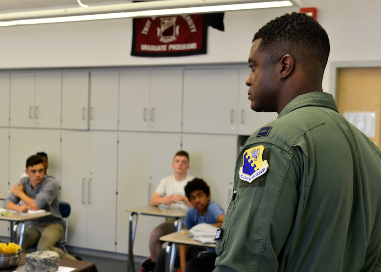 Capt. Frederick Johnson, 510th Fighter Squadron pilot, speaks with high school students during career day, May 16, 2017, at Aviano Air Base, Italy. More than 40 students attended the hour-long seminar, asking questions about colleges and careers both in the military and civilian sector. (U.S. Air Force photo by Senior Airman Cary Smith)