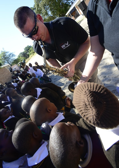 "Tech. Sgt. John Dawson, U.S. Air Forces in Europe Band saxophonist, plays his instrument for students of the Kachikau Primary School in Kachikau, Botswana on May 17, 2017. The USAFE ""Ambassadors Combo"" performance Band partnered with the Botswana Defence Force Band while supporting the 2017 African Air Chiefs Symposium and performed for over five hundred students. The U.S. and Botswana have a strong relationship, and the U.S. military has a long and productive history of working with the Botswana Defence Force.  (U.S. Air Force photo by Staff Sgt. Krystal Ardrey)"