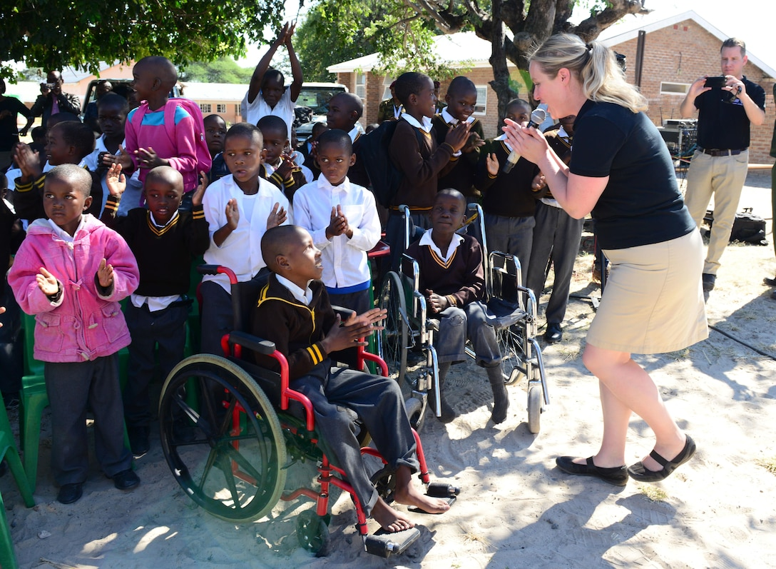 """Staff Sgt. Jill Diem, U.S. Air Forces in Europe Band vocalist, sings for students of the Kachikau Primary School in Kachikau, Botswana on May 17, 2017. The USAFE """"Ambassadors Combo"""" performance Band and the Botswana Defence Force band performed together in several concerts at schools in northern Botswana to inspire the students through the universal language of music. Botswana and the U.S. are strong partners and engagements like these help to further strengthen the bonds between our two nations. (U.S. Air Force photo by Staff Sgt. Krystal Ardrey)"""