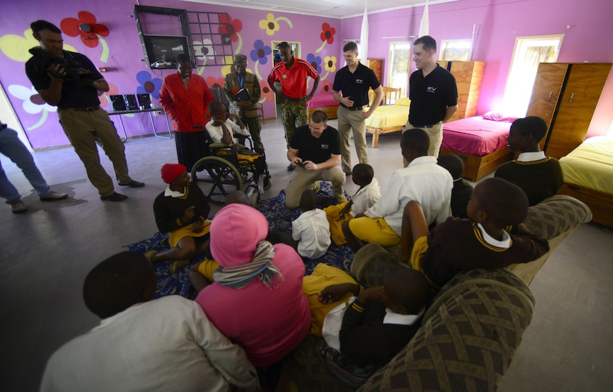 """Members of the U.S. Air Forces in Europe """"Ambassadors Combo"""" performance Band and Botswana Defence Force Band visit children at the Kachikau Primary School in Kachikau, Botswana on May 17, 2017. The bands performed a concert at Kachikau Primary School before bringing donations to and meeting with students in the special needs unit. Botswana and the U.S. are strong partners and engagements like these help to further strengthen the bonds between our two nations. (U.S. Air Force photo by Staff Sgt. Krystal Ardrey)"""
