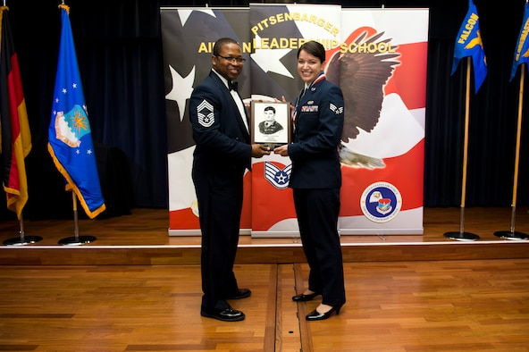 U.S. Air Force Senior Airman Madeline Ericson, 52nd Fighter Wing military justice paralegal, receives the John L. Levitow during the Pitsenbarger Airman Leadership School 17-D graduation at Club Eifel on Spangdahlem Air Base, Germany, May. 18, 2017. The Levitow award is the highest honor given to the student who displays excellence in all categories of ALS. (U.S. Air Force photo by Airman 1st Class Preston Cherry)