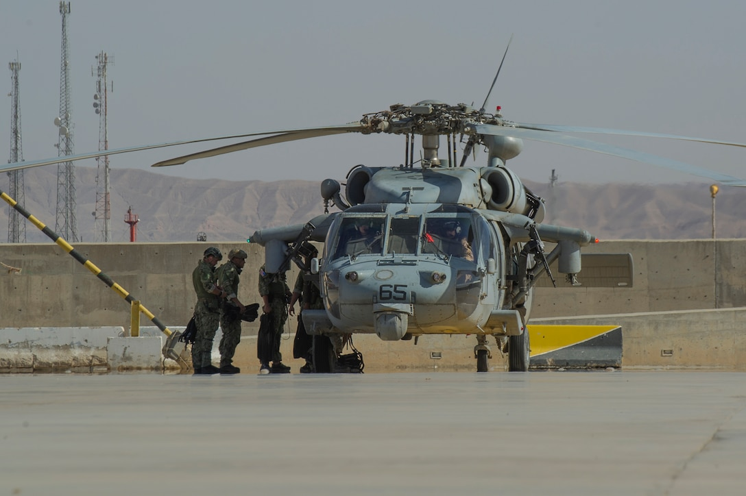 Members of Commander, Task Group 56.1, EOD Mobile Unit 12, prepare to board a helicopter for cast and recovery training during Exercise Eager Lion 2017. Eager Lion is an annual U.S. Central Command exercise in Jordan designed to strengthen military-to- military relationships between the U.S., Jordan and other international partners. This year's iteration is comprised of about 7,200 military personnel from more than 20 nations that will respond to scenarios involving border security, command and control, cyber defense and battlespace management. (U.S. Navy Combat Camera photo by Mass Communication Specialist 2nd Class Austin L. Simmons)