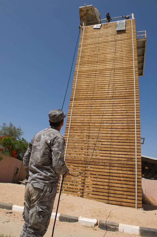 A member of the Royal Jordanian Navy conducts repelling training in support of Exercise Eager Lion 2017. Eager Lion is an annual U.S. Central Command exercise in Jordan designed to strengthen military-to- military relationships between the U.S., Jordan and other international partners. This year's iteration is comprised of about 7,200 military personnel from more than 20 nations that will respond to scenarios involving border security, command and control, cyber defense and battlespace management. (U.S. Navy Combat Camera photo by Mass Communication Specialist 2nd Class Austin L. Simmons)